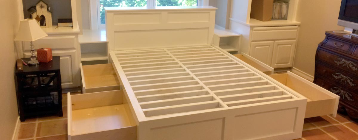 custom bed with open drawers